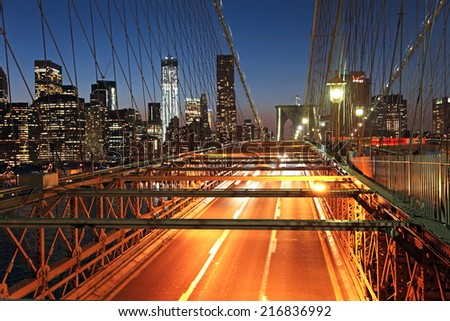 Brooklyn Bridge road lit up at night - stock photo