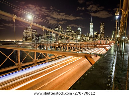 Brooklyn Bridge slow exposure with Manhattan background - stock photo