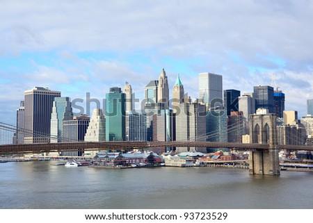 Brooklyn Bridge with lower Manhattan skyline over East River in New York City - stock photo