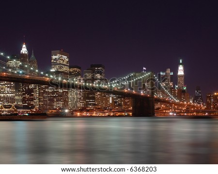Brooklyn Bridge With New York City Skyline in Background