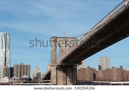 Brooklyn bridge with New York skyline in the background