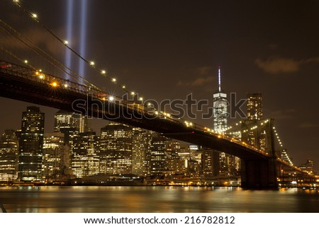 Brooklyn Bridge with The Tribute in Light at night on September 11, 2014.  - stock photo