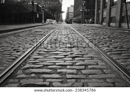 Brooklyn cobblestone street with train tracks. - stock photo