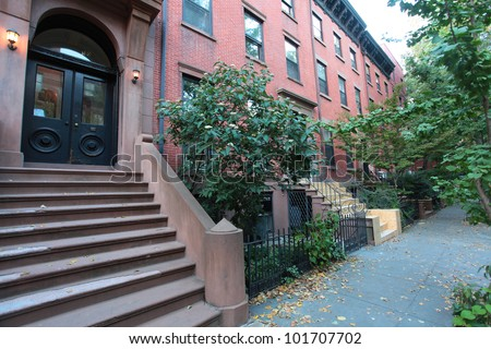 BROOKLYN HEIGHTS - Wide view of typical Brooklyn Heights Brownstones that comprise Brooklyn's oldest & most affluent neighborhood. - stock photo