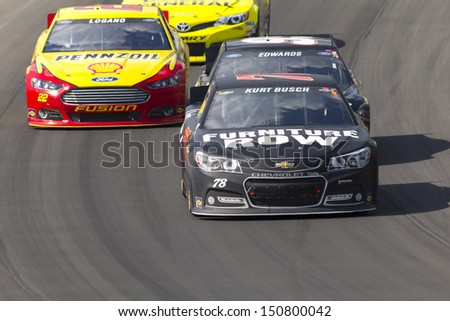 BROOKLYN, MI - AUG 18, 2013:  Kurt Busch (78) brings his race car through the turns during the Pure Michigan 400 race at the Michigan International Speedway in Brooklyn,  MI on Aug 18, 2013. - stock photo