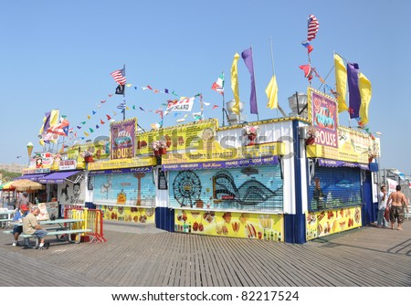 BROOKLYN, N.Y. - JUL 18: Grill House is one of many restaurants on Coney Island boardwalk, a peninsula on the Atlantic Ocean in southern Brooklyn, N.Y. populated with amusement parks. July 18, 2010. - stock photo