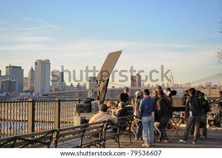 BROOKLYN, NEW YORK - APRIL 12: A Japanese film crew at work on Brooklyn Heights Promenade April 12, 2010 in Brooklyn, NY. - stock photo