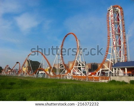 BROOKLYN, NEW YORK - AUGUST 9:The new Thunderbolt roller coaster on August 9, 2014 at Brooklyn's Coney Island. During a 2-minute ride the Thunderbolt involves a vertical drop and a zero-gravity roll. - stock photo
