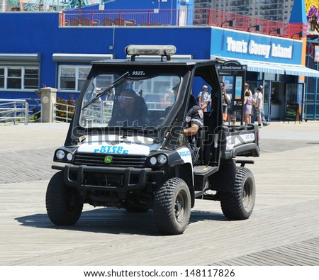 BROOKLYN, NEW YORK - JULY 30: NYPD vehicle at Coney Island Boardwalk in Brooklyn on July 30, 2013.The New York Police Department, established in 1845, is the largest police force in USA