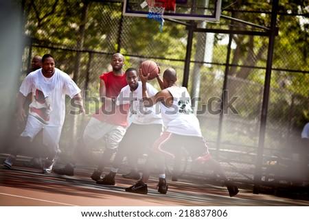 BROOKLYN, NEW YORK - JULY 2, 2011: Street basketball players on the basketball court on July 2, 2011, Brooklyn, USA - stock photo