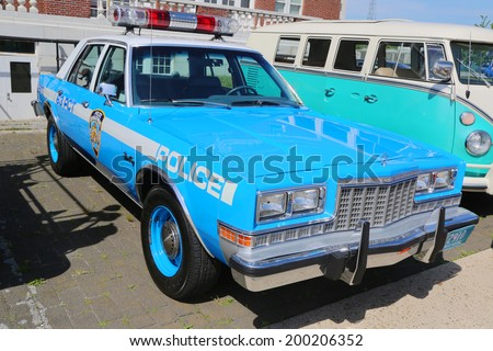 BROOKLYN, NEW YORK - JUNE 8: Vintage NYPD Plymouth police car on display at the Antique Automobile Association of Brooklyn annual Spring Car Show on June 8, 2014 in Brooklyn, New York  - stock photo