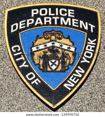 BROOKLYN,NEW YORK - MARCH 9: NYPD emblem on fallen officers memorial on March 9, 2013 in Brooklyn. 71 officers were killed when World Trade Center buildings collapsed on September 11, 2001 - stock photo