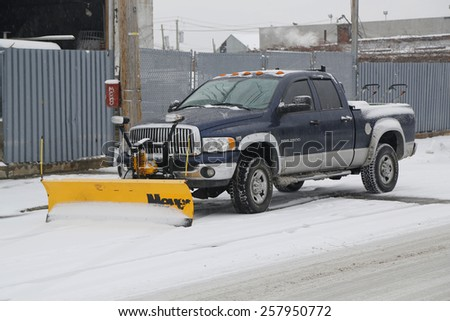 BROOKLYN, NEW YORK - MARCH 1, 2015: Snow plow truck in Brooklyn, NY ready to clean streets after massive Winter Storm Sparta strikes Northeast