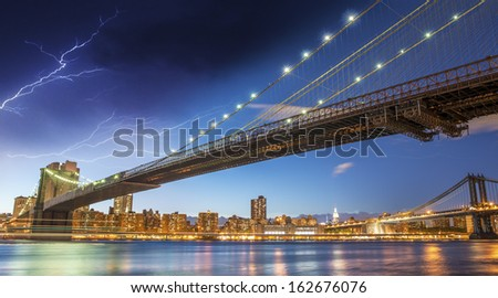 Brooklyn, New York. Night colors with storm over main city landmarks. - stock photo