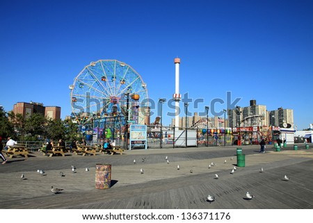 BROOKLYN, NEW YORK - OCTOBER 10:  Coney Island Boardwalk before damage by Hurricane Sandy  at Coney Island, NY. The boardwalk, built in 1923, stretches for 2.51 miles. - stock photo
