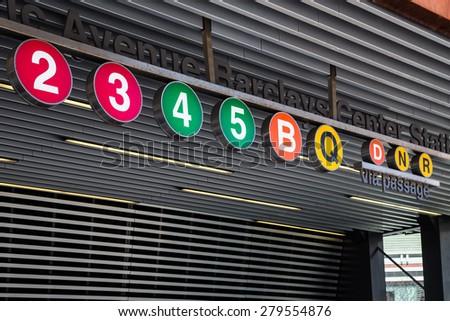 BROOKLYN, NY - APRIL 25, 2015:  Iconic New York City subway train circle signs seen at the Atlantic Avenue Station in Brooklyn. - stock photo