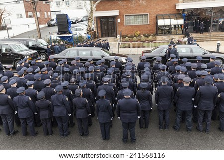 Brooklyn, NY - January 04, 2015: Police officers from around the country gather outside Aievoli Funeral Home for the funeral of slain New York City Police Officer Wenjian Liu - stock photo