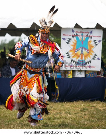 BROOKLYN, NY - JUNE 4: Powwow Native American Festival at Floyd Bennett Field on June 4, 2011 in Brooklyn, NY.  The festival attracts over 500 Native American artists, singers and dancers. - stock photo