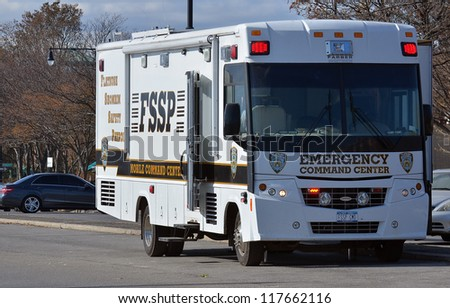 BROOKLYN, NY - NOVEMBER 04: In the aftermath of Superstorm Sandy, a NYPD brought Emergency Command Center bus at Sheepsheadbay channel on November 4, 2012 in Brooklyn, New York - stock photo