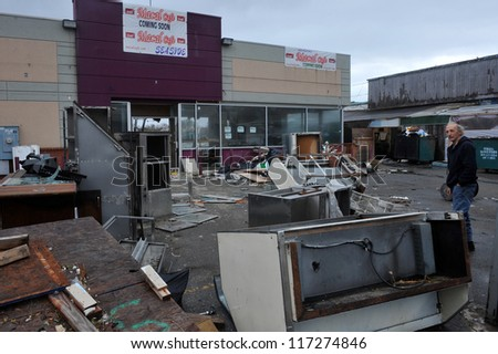 BROOKLYN, NY - OCTOBER 30: Debris and furniture litters the ground in the Sheapsheadbay neighborhood due to flooding from Hurricane Sandy in Brooklyn, New York, U.S., on Tuesday, October 30, 2012. - stock photo
