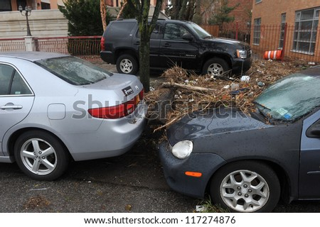 BROOKLYN, NY - OCTOBER 30: Debris litters between cars in the Sheapsheadbay neighborhood due to flooding from Hurricane Sandy in Brooklyn, New York, U.S., on Tuesday, October 30, 2012. - stock photo