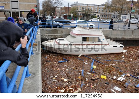 BROOKLYN, NY - OCTOBER 30: Debris litters the water in the Sheapsheadbay neighborhood due to flooding from Hurricane Sandy in Brooklyn, New York, U.S., on Tuesday, October 30, 2012. - stock photo