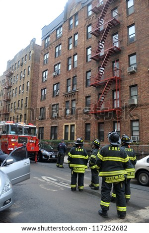 BROOKLYN, NY - OCTOBER 30: NYC fire department working in the building at Brighton Beach destroyed by strong winds from Hurricane Sandy in Brooklyn, New York, U.S., on Tuesday, October 30, 2012. - stock photo