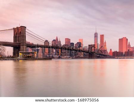 BrooklynBridge and Manhattan at sunrise, New York City. USA. - stock photo