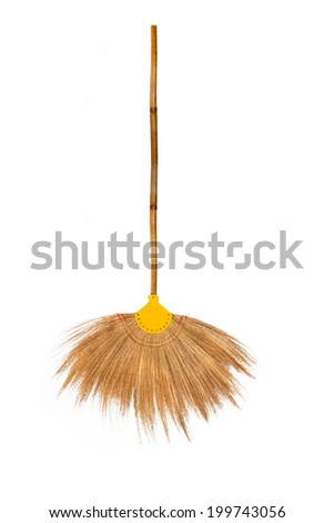 Broom made ??of grass and bamboo on white background. - stock photo