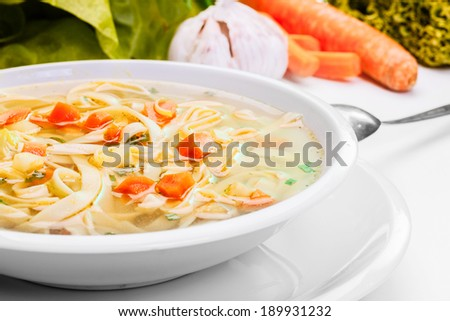 Broth - chicken soup with noodles on a plate