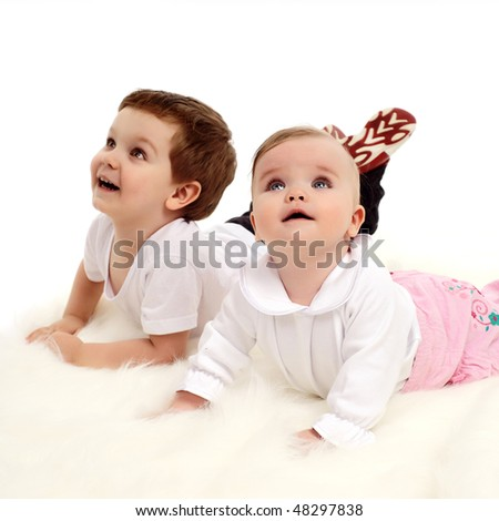 Brother and baby sister together - stock photo