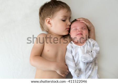 brother and newborn sister - stock photo