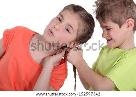 Brother and sister arguing - stock photo