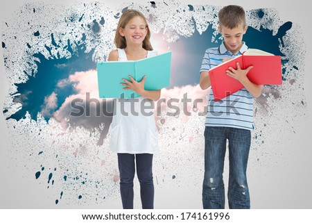 Brother and sister doing their homework together against splash on wall revealing cloud - stock photo