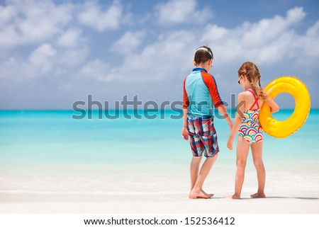Brother and sister enjoying time at tropical beach