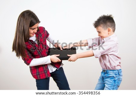 brother and sister fighting for the laptop