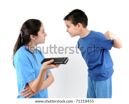 Brother and sister fighting over the TV remote control isolated on white background - a series of TV remote images. - stock photo