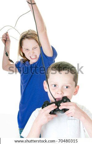 brother and sister fighting over video game - stock photo