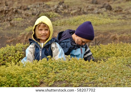 Brother and sister having fun in volcanic areas in Iceland. - stock photo