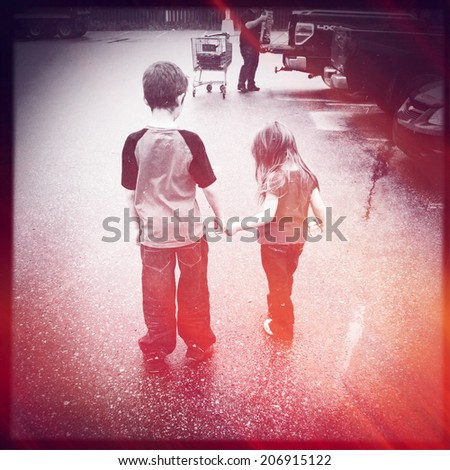 Brother and Sister holding hands with instagram effect - stock photo
