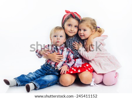brother and sister hugging white background - stock photo