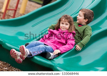 Brother and sister in a slide