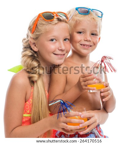 Brother and sister in bright bathing suits. Isolated. - stock photo