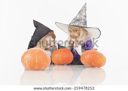 Brother and sister in fancy dress costume for halloween - stock photo