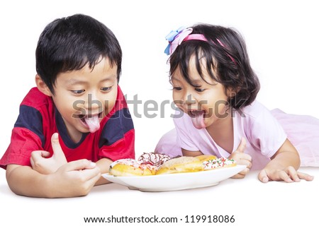 Brother and sister is having dinner together, isolated in white - stock photo