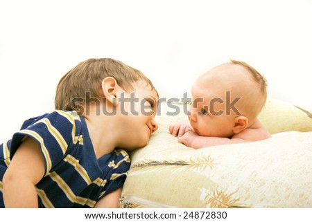 brother and sister looking at each other - stock photo