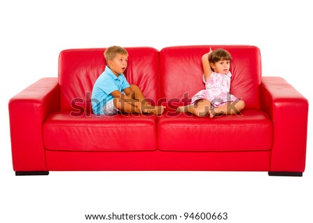 brother and sister on red sofa