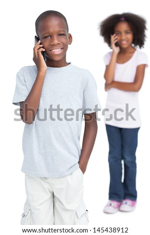 Brother and sister on the phone on a white background