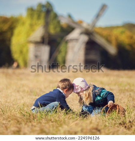 Brother and sister play together outdoor - stock photo