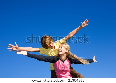 Brother and sister smiling - stock photo